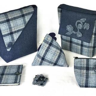 Handbags and other textile items using a blue tartan highlighted against plain blue