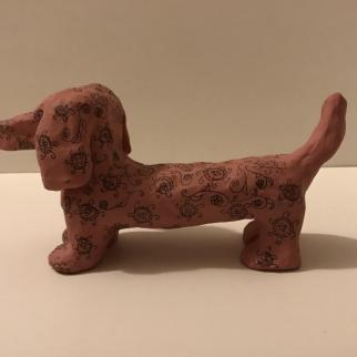 In the pink. Clay dachshund with hand drawn patterning.