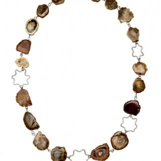 Silver linked necklace with fossil wood beads of different natural colours. Part of 'Islands' series.