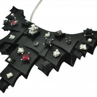 Winged empowerment statement neckpiece