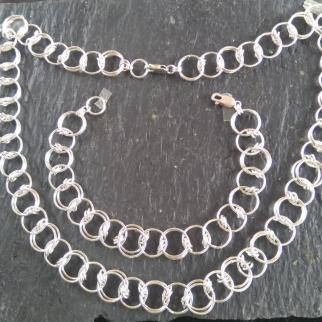 handmade sterling silver rings forming chain necklace & bracelet