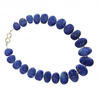Necklace of graduated flat oval lapis lazuli stones with 9 carat gold beads and handmade gold clasp.