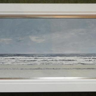 Looking out across wintry waves to the horizon on St Andrews beach