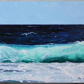 Catching the bright aquamarine hue of waves breaking onto the shoreline