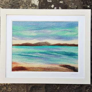Seascape made with wool fiberes.